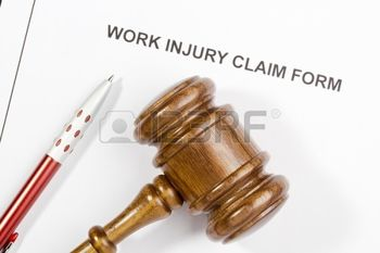 17688193-directly-above-photograph-of-a-work-injury-claim-form